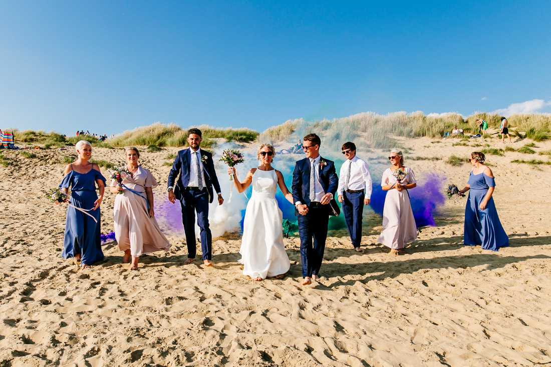 fun kent wedding photographer-smoke-grenade bridal party-camber sands the gallivant-Epic-Love-Story-085